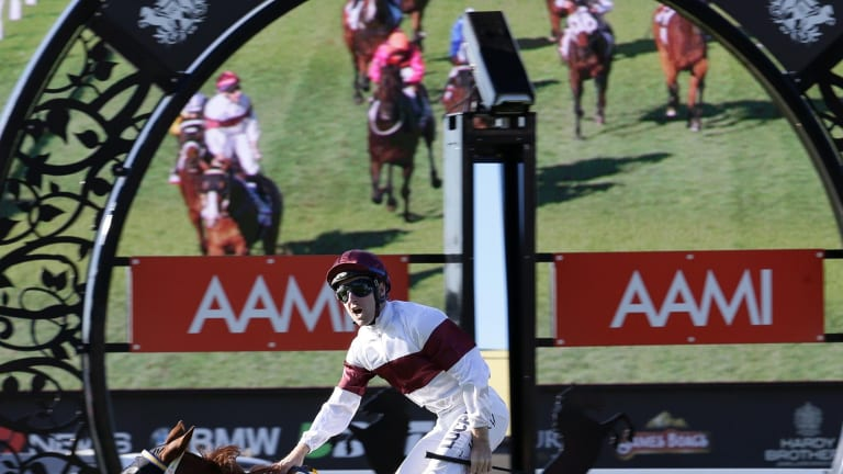 Tommy Berry riding on Eagle Way wins the Queensland Derby.