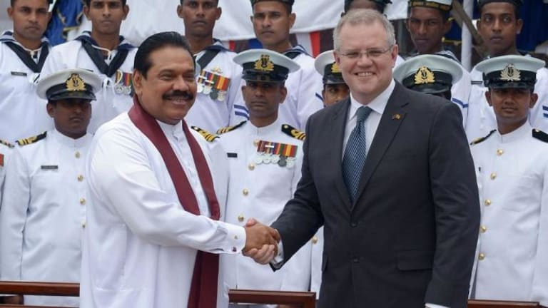 Turning back the boats ... Sri Lankan President Mahinda Rajapakse (left) shakes hands with Australia's Immigration Minister Scott Morrison in Colombo after commissioning two Australian-gifted naval patrol boats for people smuggling operations.
