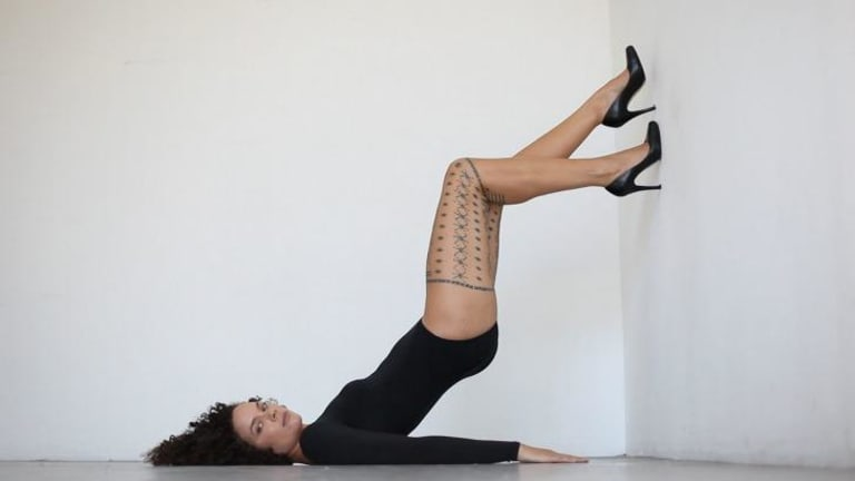 Anti-fashion: Angela Tiatia displays her malu - traditional tattoo - in <i>Walking the Wall.</i>