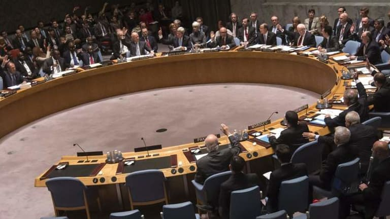 Members of the United Nations Security Council vote unanimously to approve a resolution eradicating Syria's chemical arsenal.