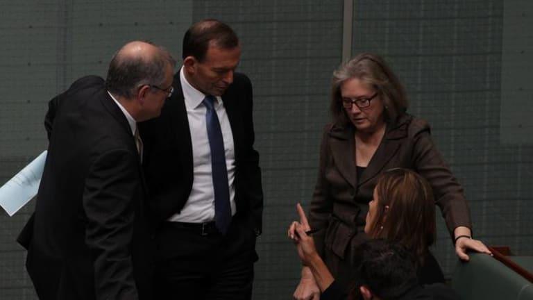 Shadow Immigration Minister Scott Morrison, Opposition Leader Tony Abbott and Judi Moylan speak with advisor Peta Credlin during the debate. Photo: Alex Ellinghausen
