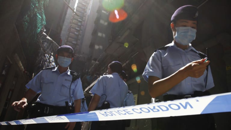 Hong Kong police seal off a hotel where a Mexican had been staying.