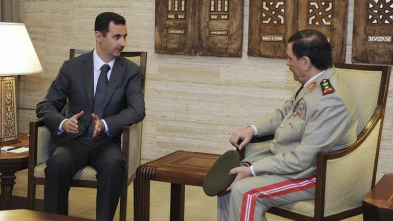 President Bashar al-Assad and newly-installed Defence Minister Fahad Jassim al-Freij in Damscus.