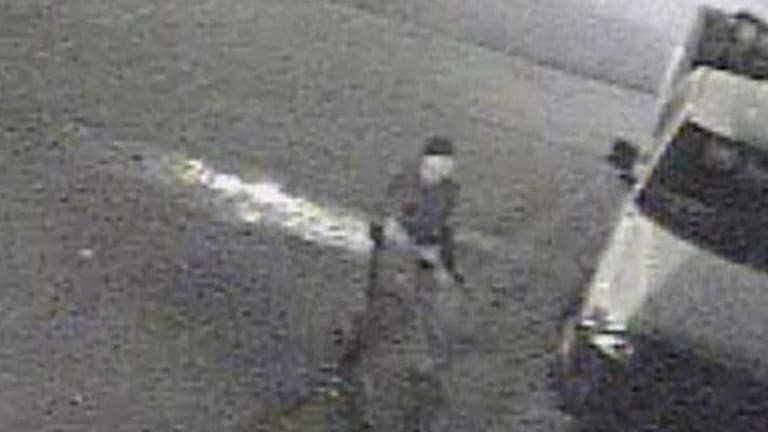 Police released a still from a video taken outside a bar where 17 people were shot. Four of the victims are critical.