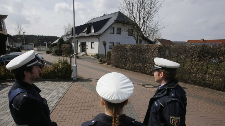Police hold media away from the house where Andreas Lubitz lived in Montabaur, Germany.