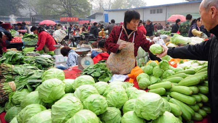 Shopping  at a  market in Beijing ... many ordinary people feel the official inflation figures underestimate the true rises.