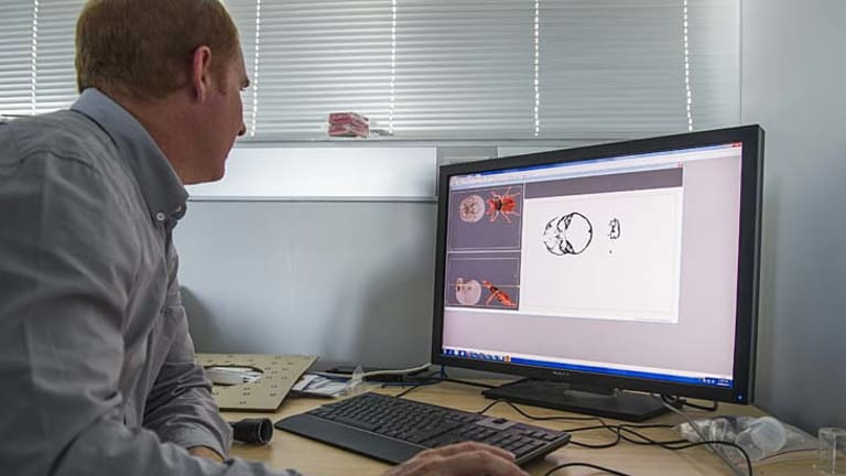 ANU Head of Applied Maths, Professor Tim Fendon, prepares a 3D file for printing.