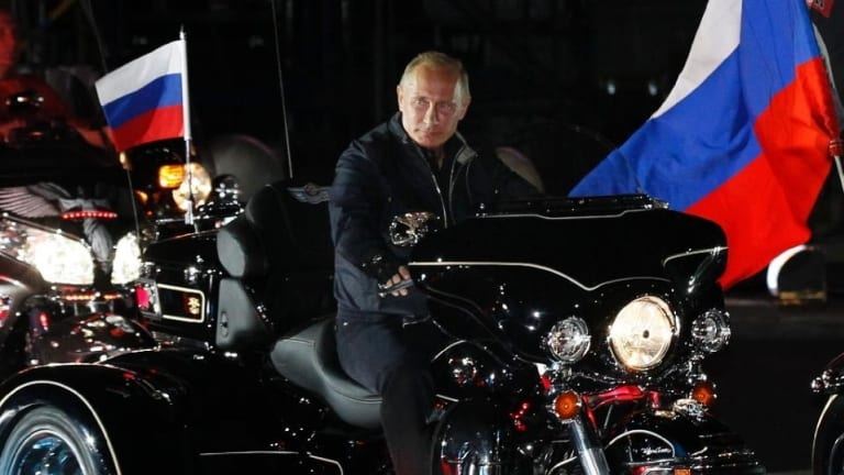 Loves his nationalist bikies ... Russia's Vladimir Putin rides a motorcycle on August 29, 2011 at a biker's festival in the Black Sea port of Novorossiysk, Russia.