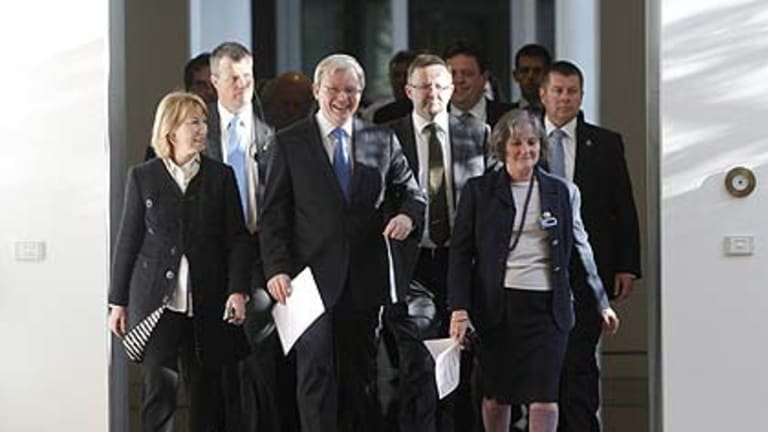 A smiling Kevin Rudd arrives for the spill vote.