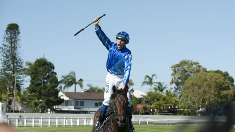 Jockey Nathan Berry celebrates his win on Unencumbered in the Magic Millions Classic at the Gold Coast in January.