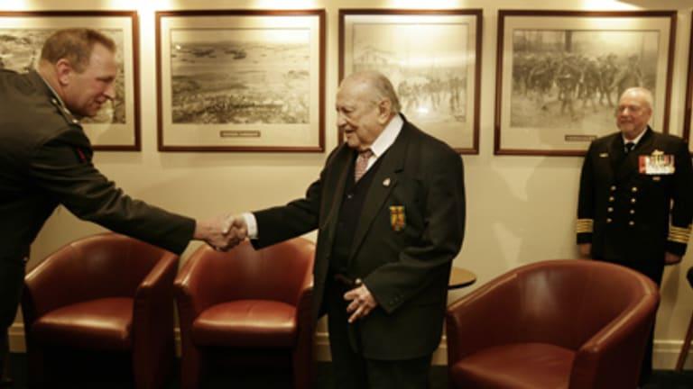Former Royal Australian Navy Sub Lieutenant Donald Reed accepts the Netherlands War Cross With Bar.
