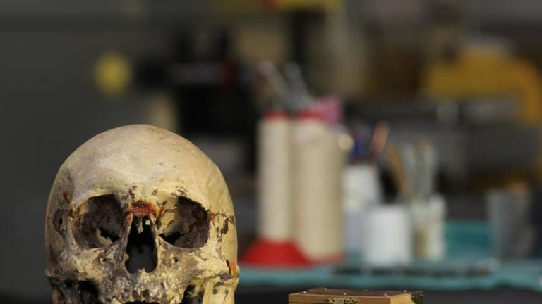 In identifying Ned Kelly's remains forensic experts also declared a skull, displayed at Old Melbourne Gaol, was not his.