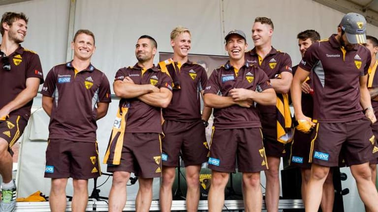 Hawthorn players are standing by teammate Dayle Garlett.