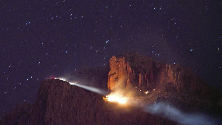Three children dead ...  a floodlight illuminates a fire from a small plane crash in the Superstition Mountains in Apache Junction, east of Phoenix.