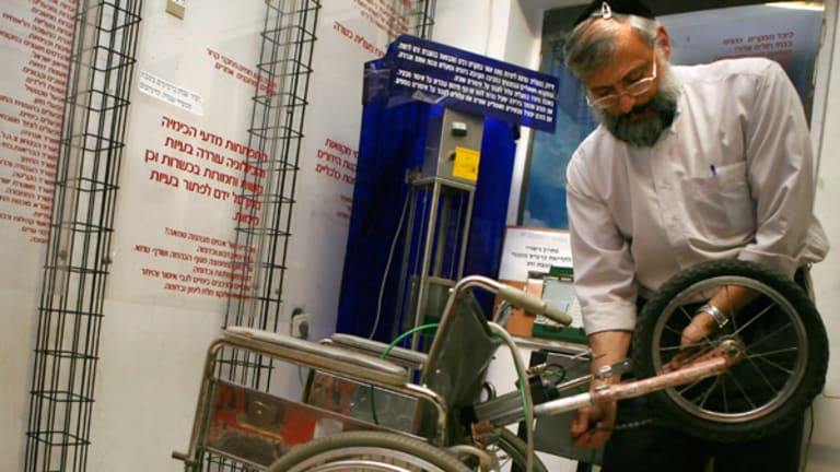 Rabbi Shmuel Strauss with the powered wheelchair.