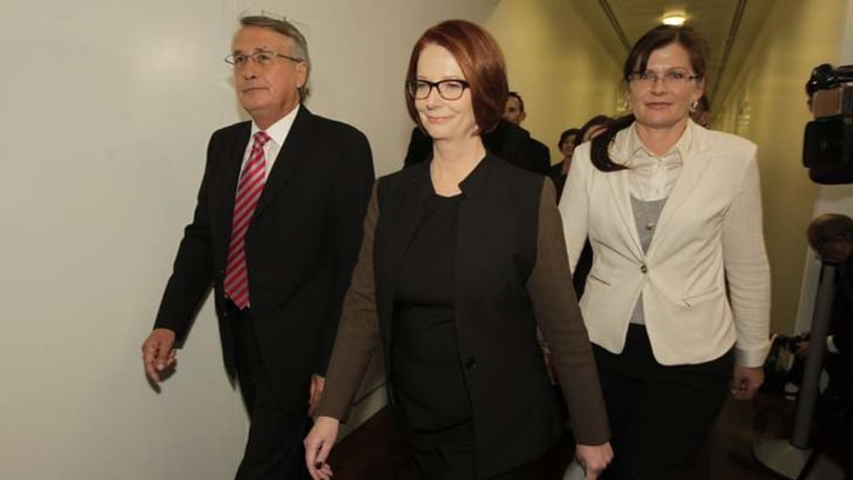 Prime Minister Julia Gillard arrives for the leadership ballot. She is standing down after losing to Kevin Rudd.
