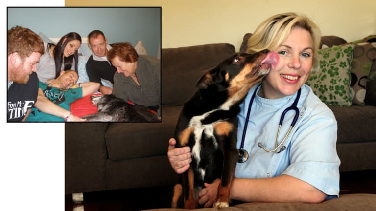 Vet Emma Whiston, with her own dog Sally, knows at first hand the strong bonds people share with their pets. Inset: Sue Floyed and her family with their kelpie cross, Sarah.