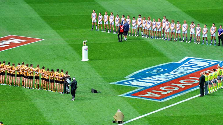 The teams face off during the national anthem.
