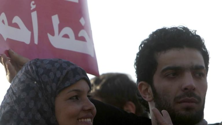 Samira Ibrahim, left,  at a protest against military council violations and virginity tests against females at Tahrir Square in Cairo.