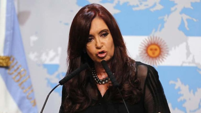 Not happy ... Cristina Kirchner takes aim at Britain, a map of the Falklands at her shoulder. Photo: Reuters