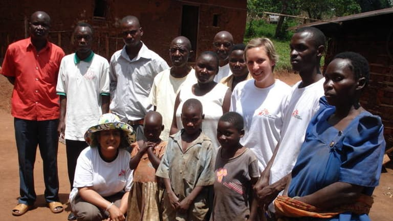 Kamalini Lokuge, wearing the hat, with other  Médecins Sans Frontières volunteers and a family in Uganda who lost 11 members to the deadly virus.