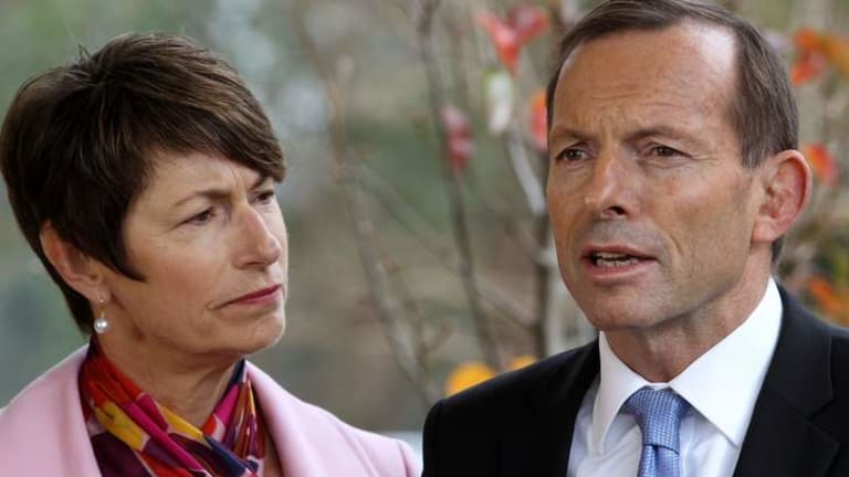 Opposition Leader Tony Abbott and wife Margie at a school on Monday where he made his comments about the switch to an emissions trading scheme.