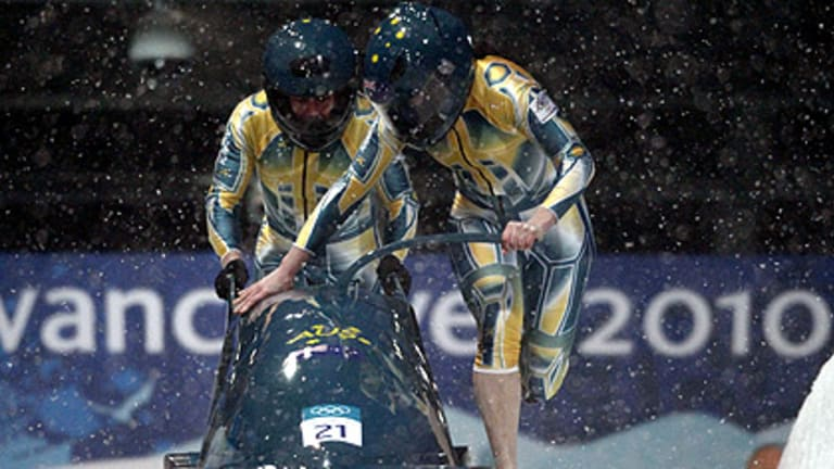 Cool runnings ... Astrid Loch-Wilkinson, right, and Cecilia McIntosh start their run during a women's bobsleigh heat at the Vancouver 2010 Winter Olympics.