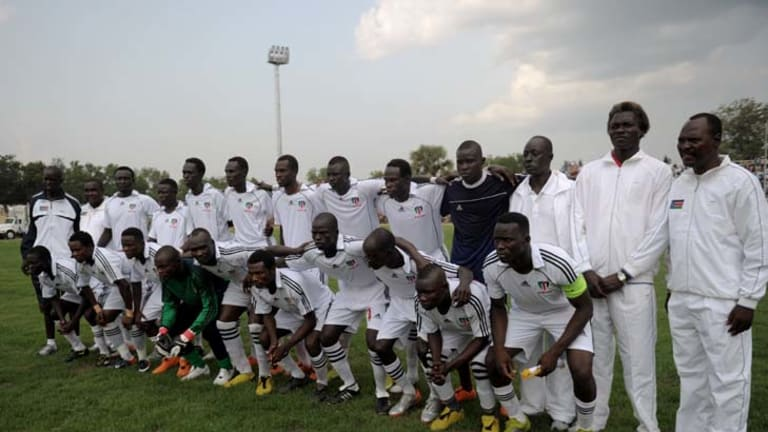 South Sudan's national soccer squad pose for a photograph prior to their first international football game.