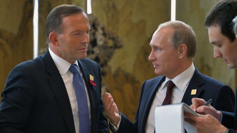 Tony Abbott speaks to Vladimir Putin in Beijing on Tuesday.