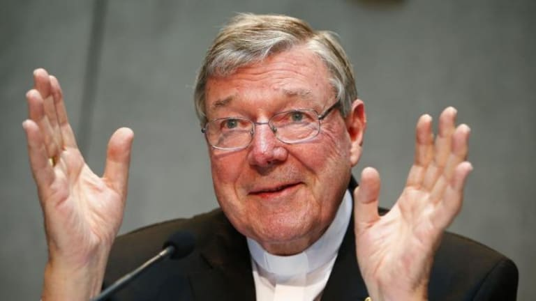 Sweeping changes ... Cardinal George Pell outlines his plans to restructure the scandal-ridden Vatican Bank as he introduces the institution's new president, French businessman Jean-Baptise de Franssu, at the Vatican.