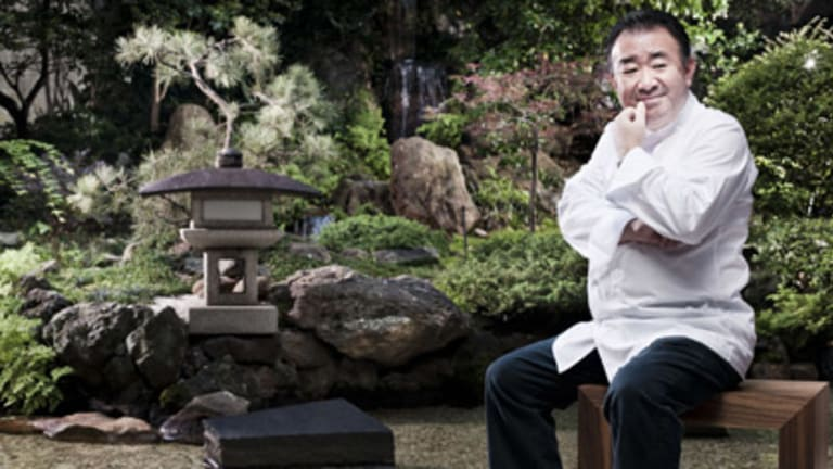 The thought had crossed his mind . . . Tetsuya Wakuda sans hat in the Japanese garden at his Kent Street restaurant, but there are still two hanging around.