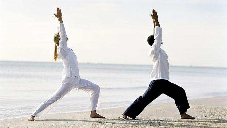 Yoga on the beach at Chiva Som.