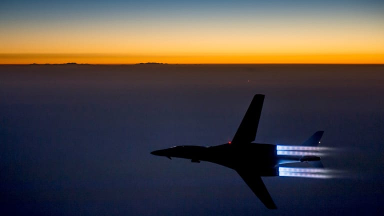In this photo released by the US Air Force, a plane flies over northern Iraq after conducting airstrikes in Syria against Islamic State group targets in Syria.