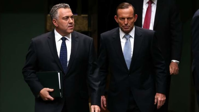 Treasurer Joe Hockey and Prime Minister Tony Abbott. Mr Abbott has wrongly claimed that former PM John Howard took a big hit in the polls after delivering a tough first budget in 1996.