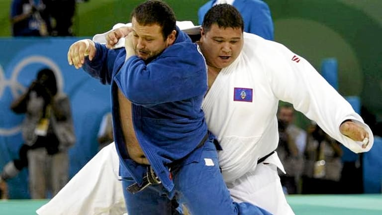 Ricardo Blas Jr (white) competes in the men's heavyweight division in judo at the Beijing Olympics.