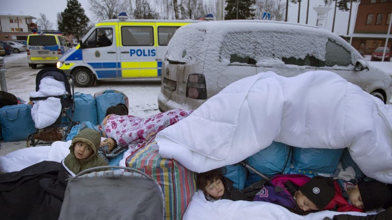 Migrant children from Syria sleep outside the Swedish Migration Board, in Marsta, Sweden, last month.