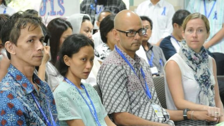 Two teachers held by Indonesian police without charge: Ferdinant Tjiong (left) with his wife, Fransisca, and Neil Bantleman, with his wife Tracey.