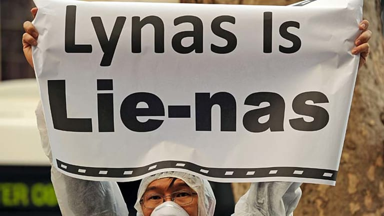 An activist protests outside the Lynas Corprations headquarters in Sydney.