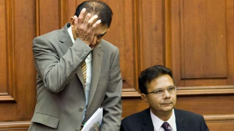 Vinod Hindocha, father of Anni Dewani, rubs his eye in court.