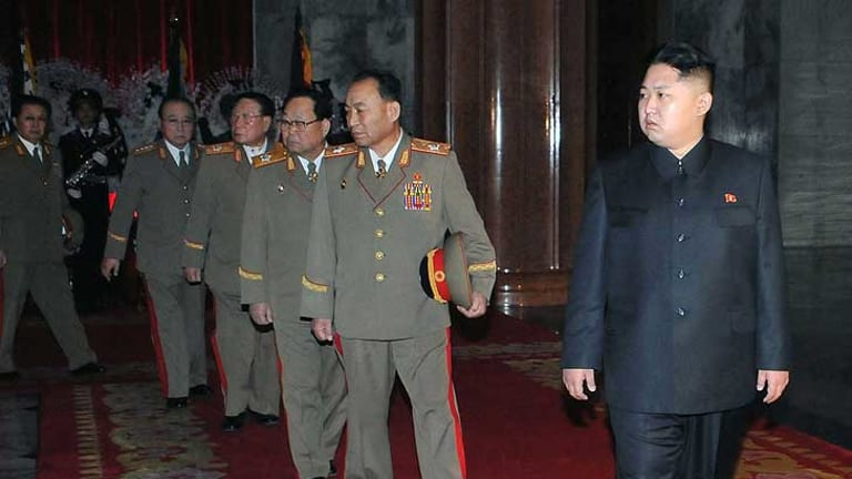 Kim Jong-un walks with  top military officers, including Jang Song-thaek, left,  as they pay their respects to former leader Kim Jong-il lying in state at the Kumsusan Memorial Palace in Pyongyang.