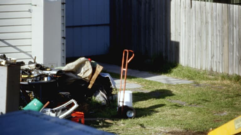 Suspected crime scene ... charred grass yesterday marred the backyard where burnt human remains were found.