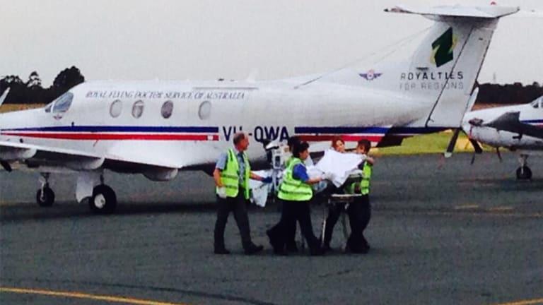 Shark attack victim Greg Pickering at Jandakot Airport, on his way to hospital in Perth.