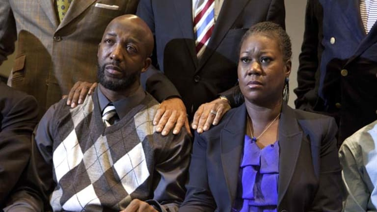 Sorrow … Trayvon Martin's parents, Tracy Martin and Sybrina Fulton, hear murder charges will be laid against George Zimmerman.