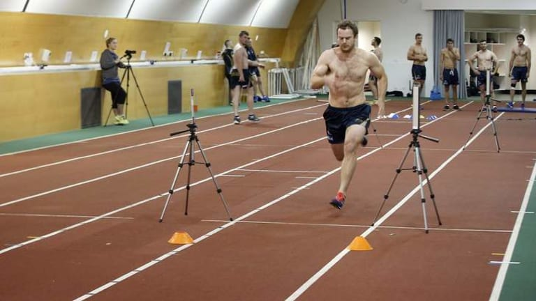 ACT Brumbies player Pat McCabe undergoes biometric testing in the AIS Indoor Athletics Track.