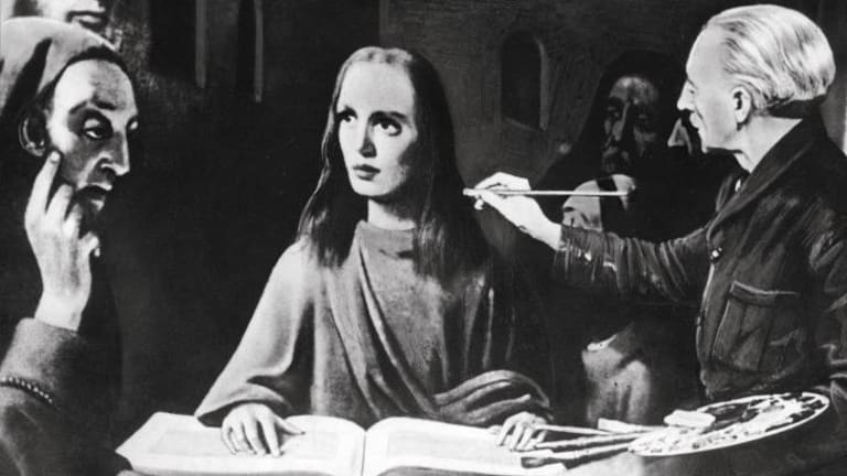 Han van Meegeren painting Christ Among the Doctors, after Johannes Vermeer, during his trial in Amsterdam, 1945. Copyright Indianapolis Museum of Art, Gift of Mr. and Mrs. Joseph E. Cain.