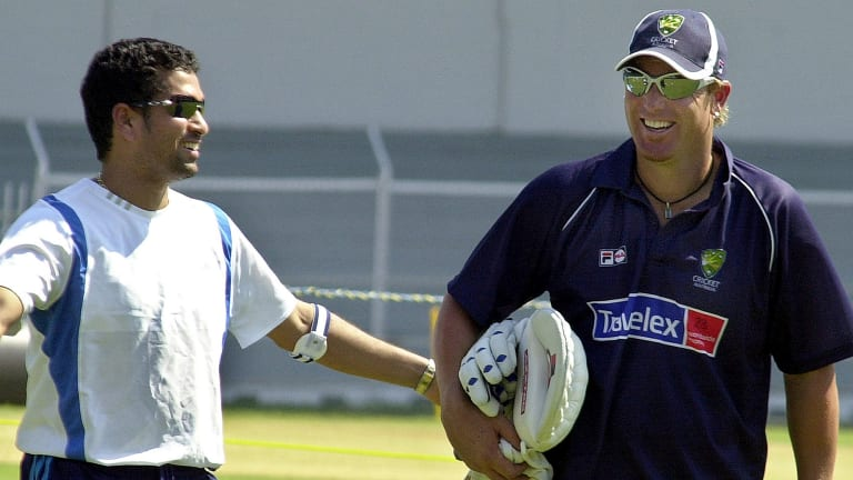 India's batsman Sachin Tendulkar, left, shares a laugh with Australian bowler Shane Warne, during a training session in Bombay, India, Wednesday, Sept. 29, 2004. The Australian cricket team is in India to play a four test match series beginning Oct. 6. (AP Photo/Aijaz Rahi)