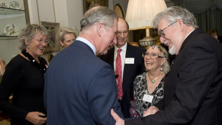 Germaine Greer, left, has called Australian authorities arsonists at a function attended by Britain's Prince Charles, second left, and Rolf Harris, right.