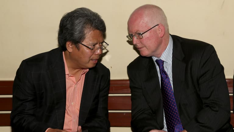 Todung Mulya Lubis, left, talks to Australian lawyer Julian McMahon before the Bali NIne legal challenge on Tuesday.