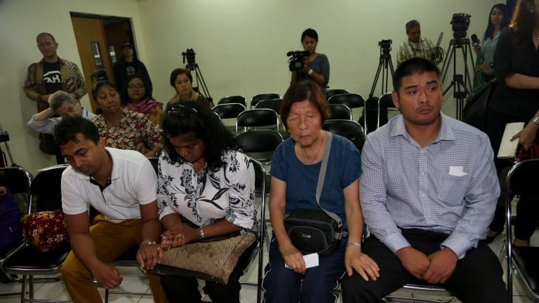 From left: Myuran Sukumaran's brother, Chinthu, mother Raji, Andrew Chan's mother, Helen, and brother Michael.