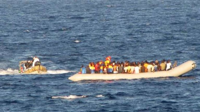 """Migrants are rescued off the coast of Sicily. More than 2000 migrants were rescued by Navy ships and patrol boats over three days as part of the """"Mare Nostrum"""" operation."""